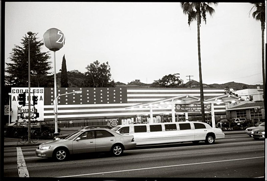 Stretch limo and long flag